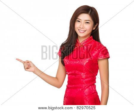 Chinese woman with cheongsam and finger point up