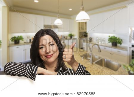 Smiling Hispanic Woman With Thumbs Up in Beautiful Custom Kitchen.