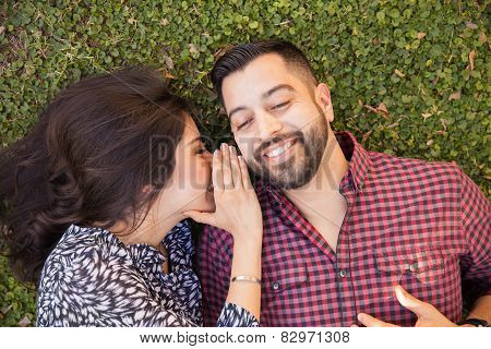 Couple Talking In Secret