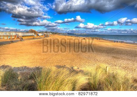 Sandbanks beach Poole Dorset England UK with cloudscape like painting in vivid bright colour HDR