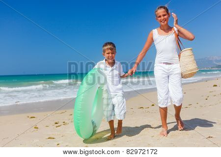 Kids play on the beach