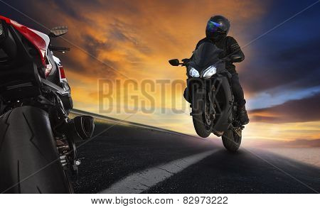 Young Man Riding Motorcycle On Asphalt Highways Road With Professional Extreme Biking Skill Use For