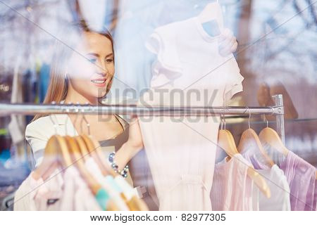 Elegant young woman shopping in boutique