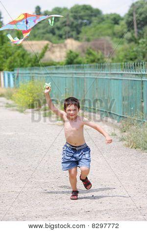 Little Boy Flying Kite