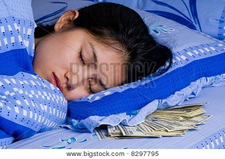 Woman With Money Under Her Pillow