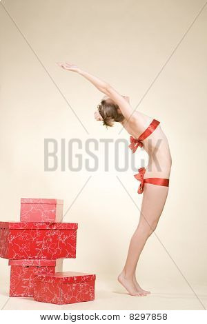 Sexy Woman Near The Present Boxes