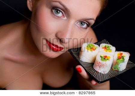 Pretty Woman Is Holding A Plate With Japanese Food