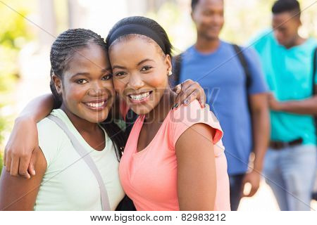 two pretty african american college friends on campus