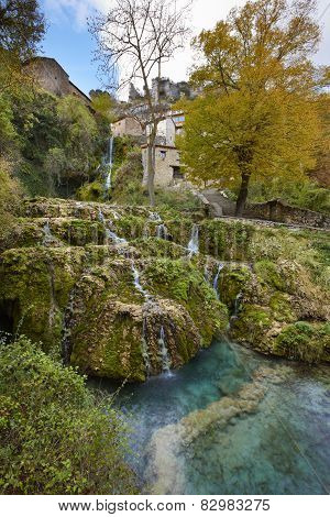 Rural Village With Waterfall In Spain. Orbaneja Del Castillo. Burgos