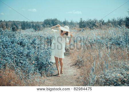 Woman Walking In Wonderland