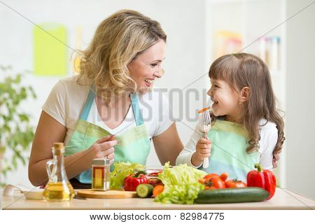mother and her kid preparing healthy food and having fun