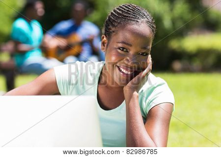 beautiful african university student with a computer