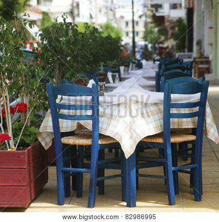 Blue chairs on a greek cafe on Zakinthos