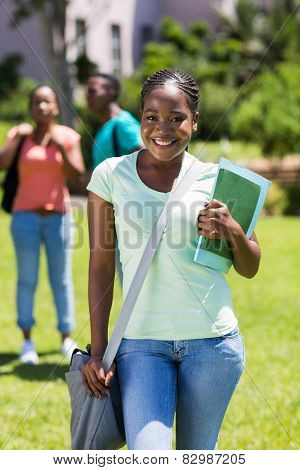 beautiful afro american university student with books