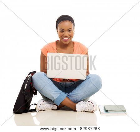 attractive female african college student using laptop isolated on white background