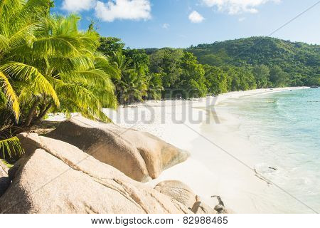 Beautiful and a famous beach Anse Lazio seen from the granite boulders, Praslin island, Seychelles.
