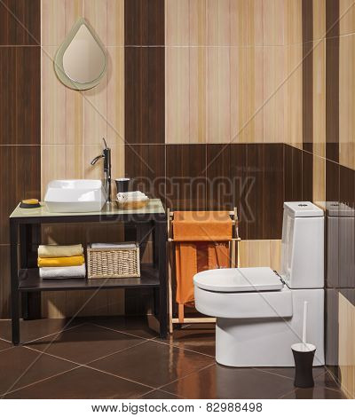 Detail Of A Modern Bathroom With Sink, Toilet And Laundry Basket