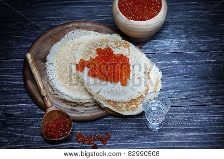 Pancakes With Red Caviar And A Vodka Wine-glass