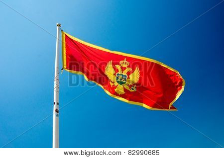 A montenegrin flag waves in the wind