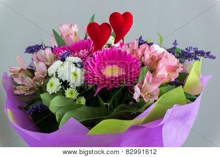 Red hearts and a bouquet of flowers
