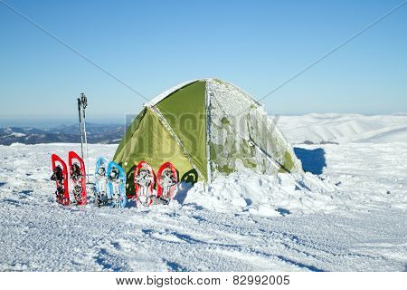 Camping during winter hiking in Carpathian mountains.