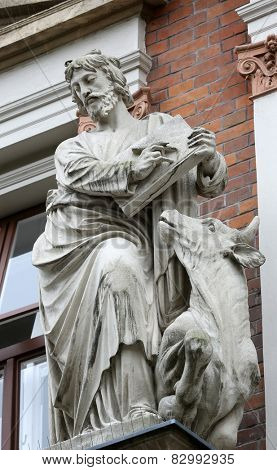 VIENNA, AUSTRIA - OCTOBER 10: Saint Luke the Evangelist on the facade of Evangelical School in Vienna, Austria on October 10, 2014.