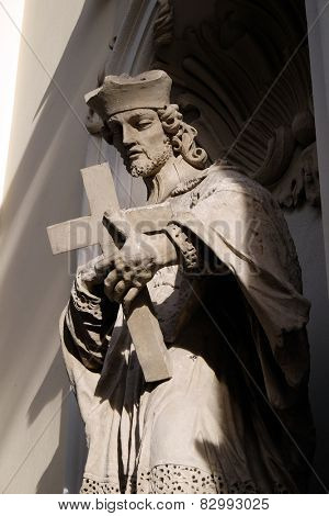 GRAZ, AUSTRIA - JANUARY 10, 2015: Saint John of Nepomuk on the facade of Parish Church of the Holy Blood in Graz, Styria, Austria on January 10, 2015.
