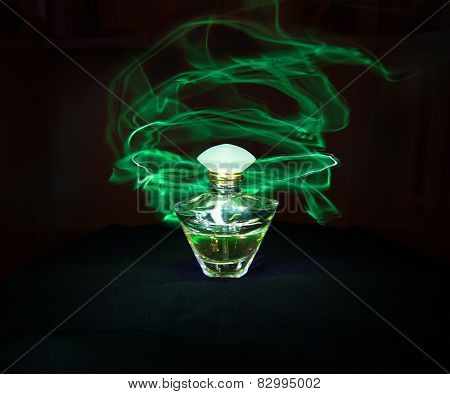 Perfume Bottle And Green Light Painting