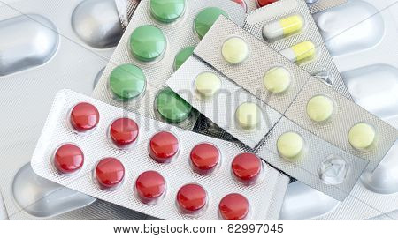 A Variety Of Different Colored Pills For The Treatment