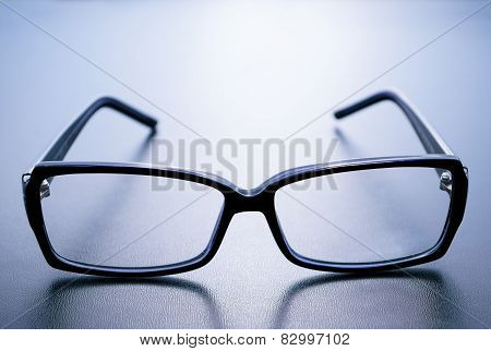 Horn-rimmed Glasses On Blue Background
