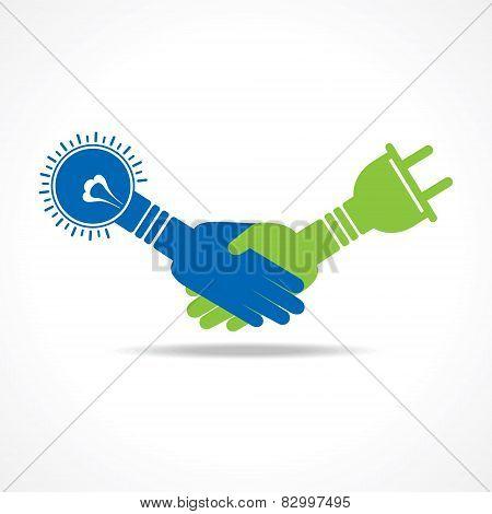 Green energy concept. handshake of light bulb and plug