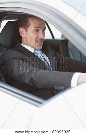 Businessman nearly crashing his car during his trip