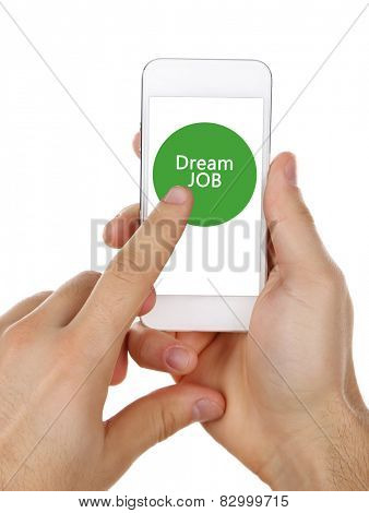 Smart phone in hands and Dream Job text on screen, Job searching concept