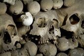 picture of eye-sockets  - old bones and skulls in the Gothic vault of Kutna Hora - JPG