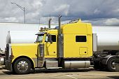 foto of oversize load  - Yellow Semi Truck parked in rest area - JPG