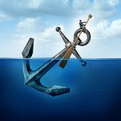 stock photo of anchor  - Positive thinking and resilience business concept with a person on a floating anchor rowing with a paddle as a symbol of moving forward despite restrictions and challenges - JPG