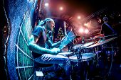 stock photo of drums  - Drummer playing on drum set on stage - JPG