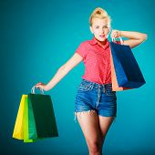 picture of pinup girl  - Pinup girl young woman in retro style buying clothes - JPG