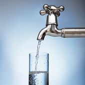 foto of tapping  - clean water is poured into a glass from the tap - JPG