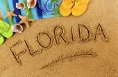 pic of starfish  - The word Florida written on a sandy beach with scuba mask beach towel starfish and flip flops - JPG