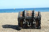 pic of treasure chest  - Old Classic Wood and Iron Treasure Chest on the Beach - JPG