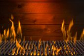 image of flames  - BBQ flames background image with iron grill and wood - JPG