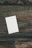 stock photo of polaroid  - Polaroid on the wooden table - JPG