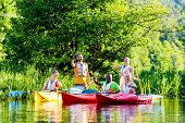 foto of kayak  - Friends driving with kayak on forest river - JPG