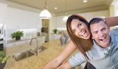 stock photo of rebuilt  - Playful Young Military Couple Inside Home with Beautiful Custom Kitchen - JPG
