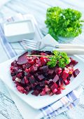 image of beet  - beet salad on plate and on a table - JPG