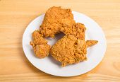 stock photo of southern fried chicken  - Fresh crunchy fried chicken on a white plate - JPG