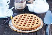 stock photo of cherry pie  - Homemade cherry pie on wooden table - JPG