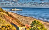 Bournemouth beach pier and coast Dorset England UK like a painting in vivid bright colour HDR poster