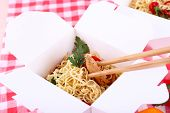 picture of chinese checkers  - Chinese noodles and sticks in takeaway box on fabric background - JPG